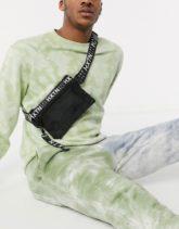 HXTN Supply - Schwarze Umhängetasche mit Logo