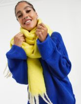 ASOS DESIGN - Flauschiger, langer Schal mit Quasten und zweifarbigem Design in Gelb
