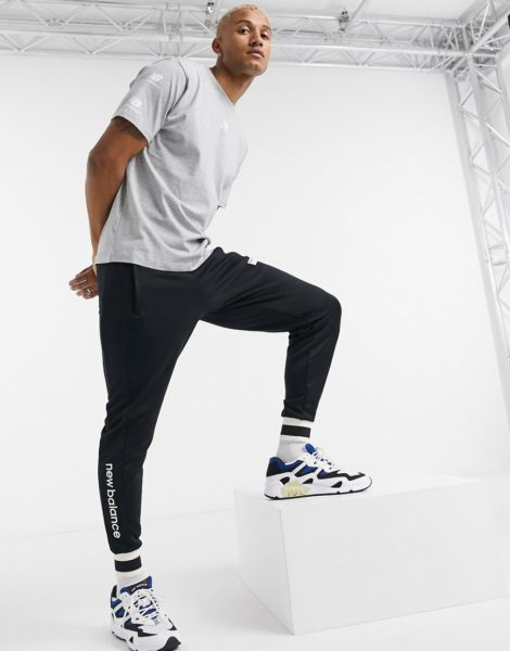 New Balance - Graues T-Shirt mit Logo