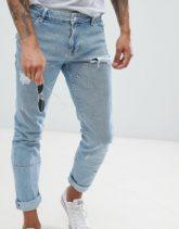 ASOS DESIGN - Enge Jeans in leicht verwaschenem Blau mit eingesetzten Stoffteilen