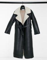 ASOS DESIGN - Langer Mantel im Lederlook in Schwarz und Creme mit Gürtel