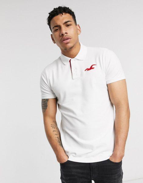 """Hollister - Schmal geschnittenes Polohemd mit """"explodiertem"""" Logo in Weiß"""