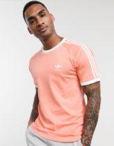 adidas Originals - T-Shirt mit drei Streifen in Rosa
