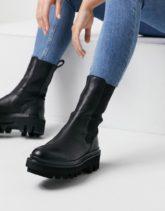 AllSaints - Billie - Chelsea-Stiefel mit hohem Schaft und dicker Sohle aus Leder in Schwarz