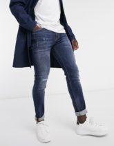 Calvin Klein Jeans - Schmale Jeans - im Used-Look in mittlerer Waschung-Blau
