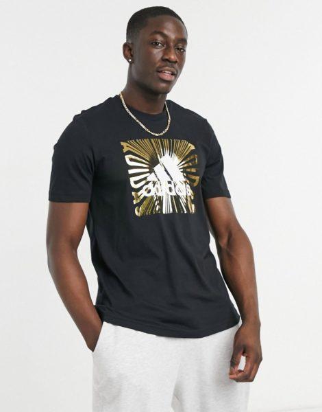 adidas - Extrusion motion - T-Shirt in Schwarz mit goldfarbener Foliengrafik