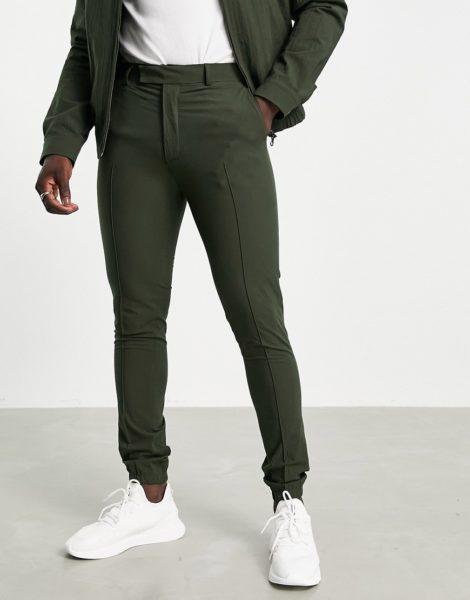 ASOS DESIGN - Elegante Hose mit engem Schnitt und sportlichen Bündchen aus grünem Seersucker