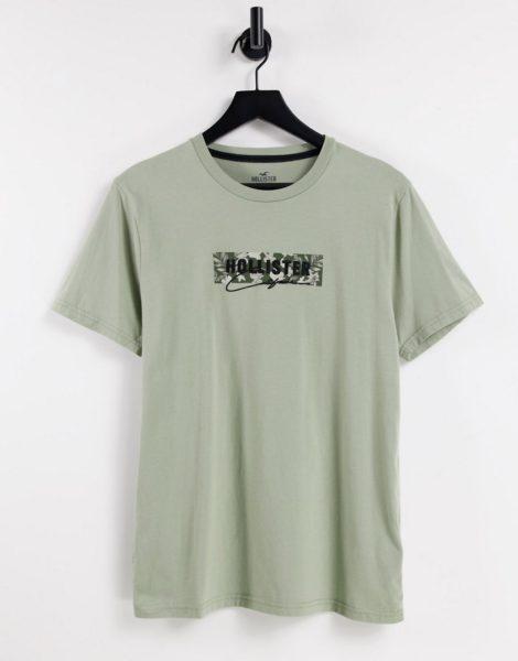 Hollister - Tech - T-Shirt in Olivgrün mit Brust- und Rückenlogo-Weiß