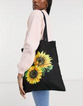 ASOS DESIGN - Shopper-Tasche aus Leinen mit Sonnenblumen-Print in Schwarz